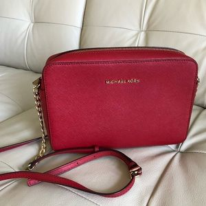I am selling my red Michael Kors crossbody